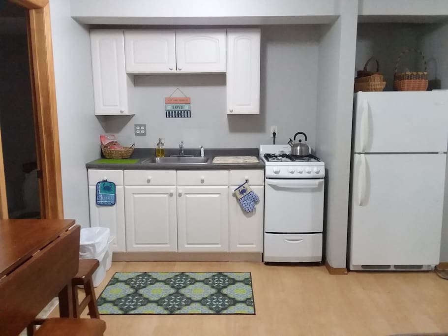 Kitchen with new stove, oven and full size refrigerator.