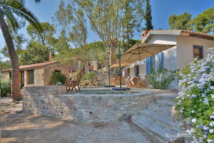 1915 build traditional cottage in love bay Poros.