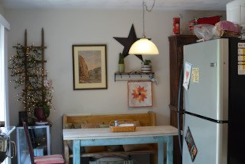 Cozy kitchen area is ready for a cup of coffee or a good conversation while preparing a meal during your stay.