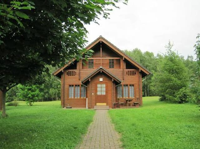 Cozy wooden cottage for 8+ people stands quietly at the edge of the forest in the holiday village