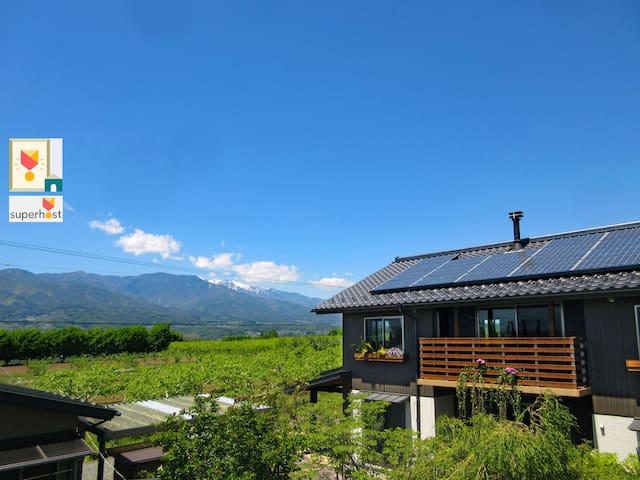 Country side home. Central Alps mountain view.