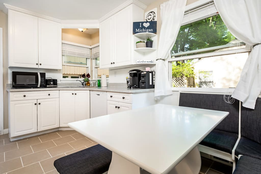 Our breakfast nook is perfect for starting your morning.  The natural light compliments the white kitchen wonderfully.