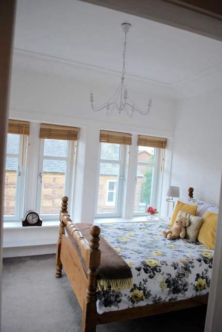 Originally a weavers mill, the bedroom boasts six windows where weavers would take advantage of the natural light.