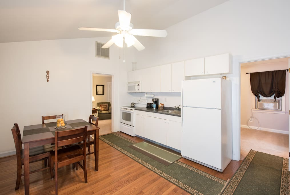 Full kitchen with microwave, k-cup coffee maker, and table for four.
