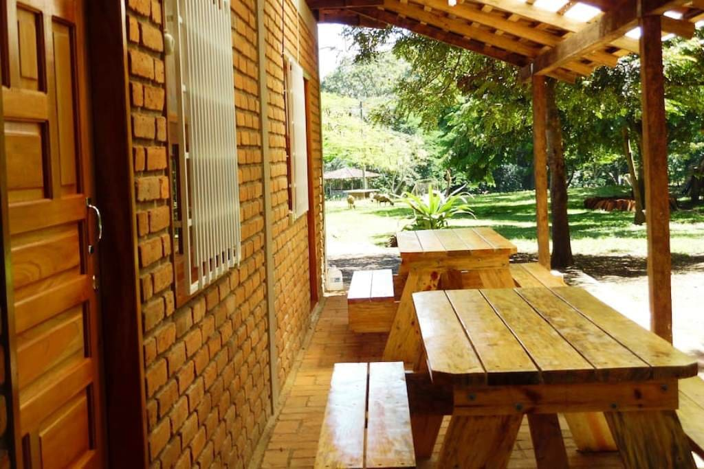 Private terrace outside group room with wooden picnic table