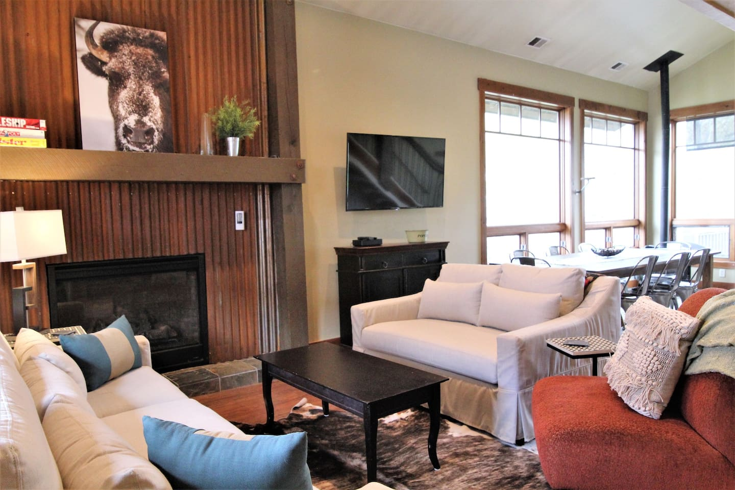 The open living/dining/kitchen features a gas fireplace, comfy couches, and seating for 10. Grab a hot drink from the coffee bar and cozy up with a puzzle or provided board games and puzzles.