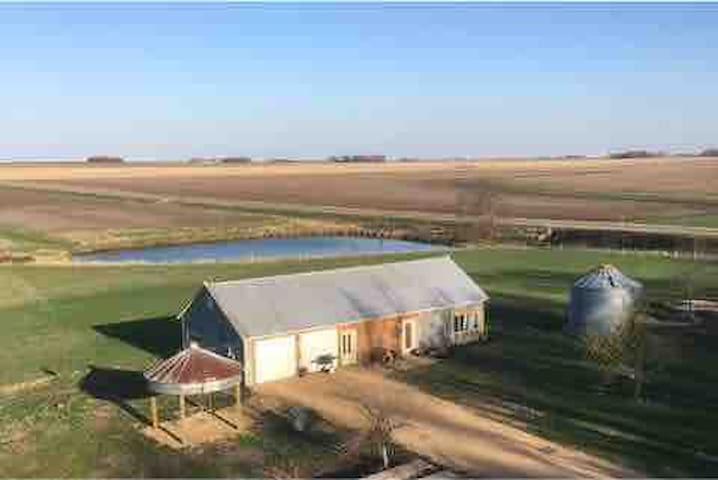 Converted machine shed home with pond and Lamkin creek bordering the property.