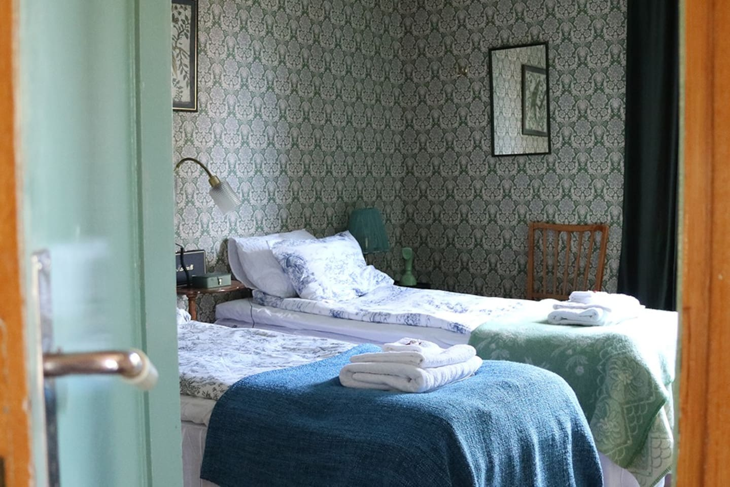 Bedroom 1: two single beds.