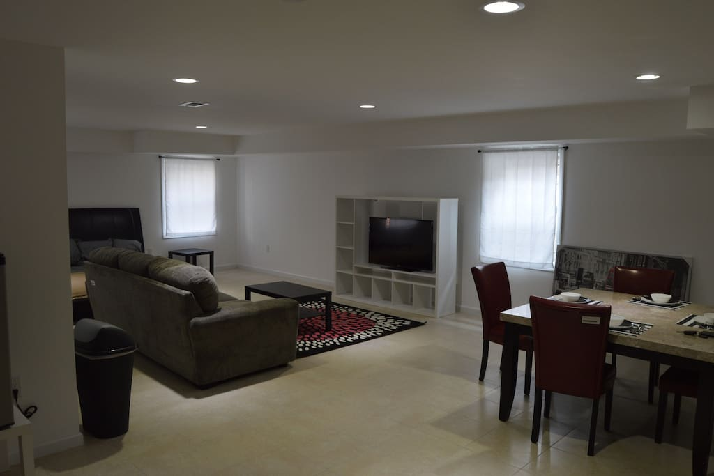 """Dining and living area with 48"""" tv and marble dining table"""