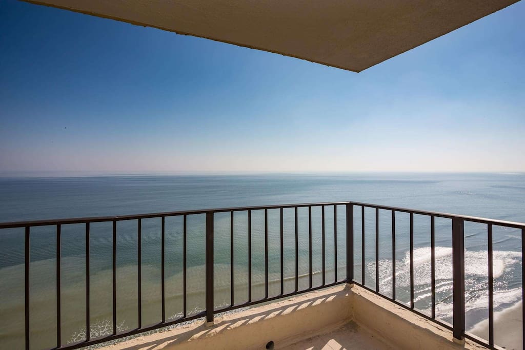 Commanding view of the ocean and beach from this corner balcony