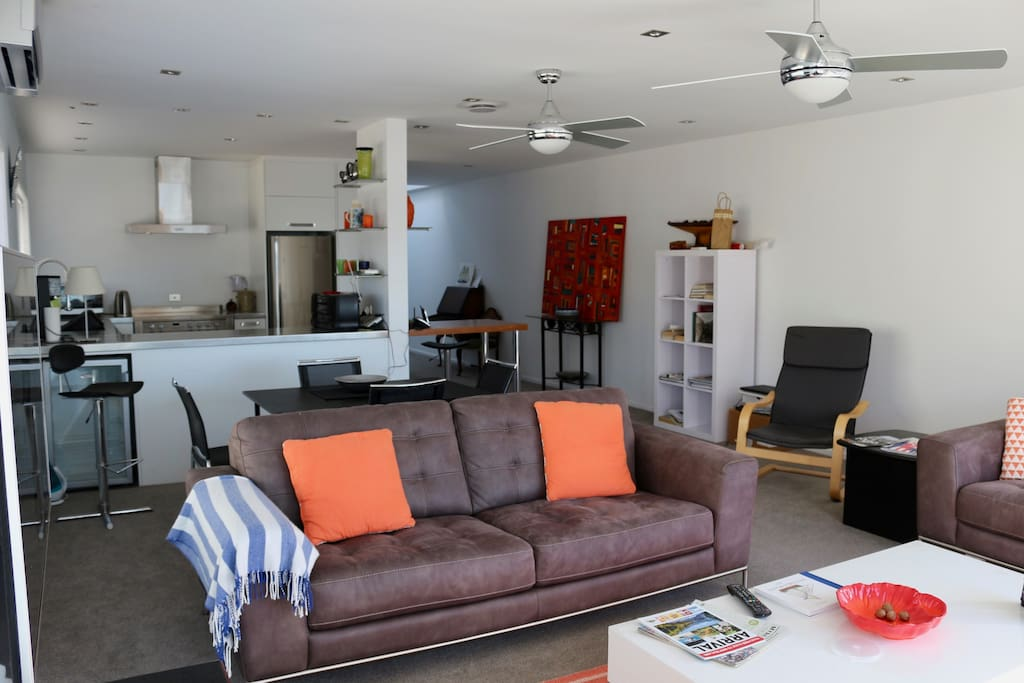 Open plan living space complete with flatscreen TV and heatpump