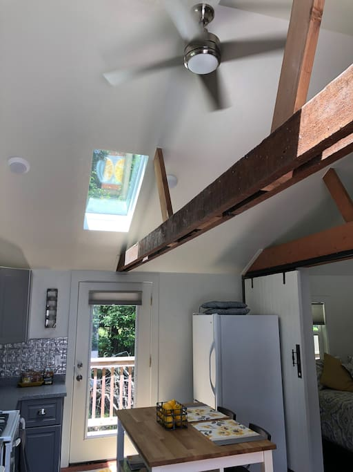Open beam construction and skylights add to the bright cheeriness of the cottage.
