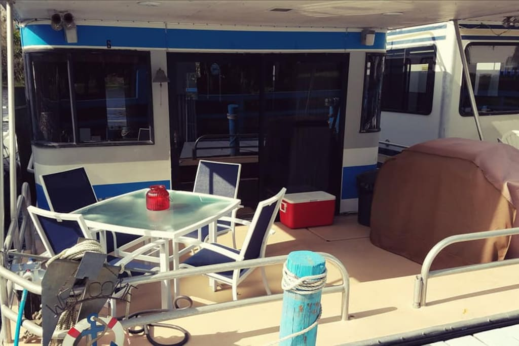 The forward deck features a gas grill, cooler and 4-top table.  Great place to enjoy lunch or dinner.