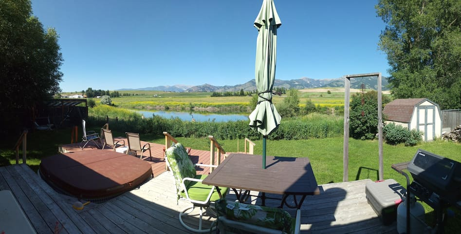 Stay Beside a Wildlife Pond with Mountain Vistas!