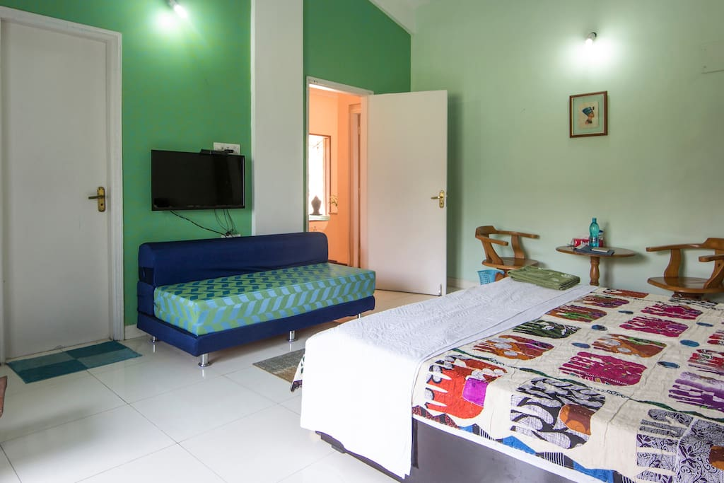 LED TV and Sofa that can be spread to accommodate two more guests
