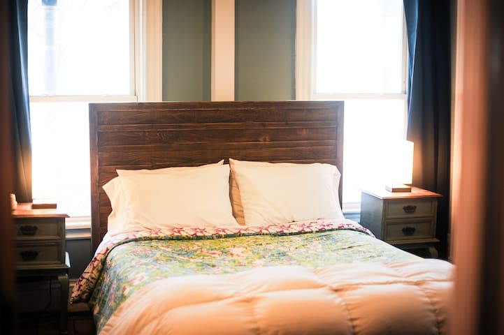 Queen bed, sound machine, and black out drapes in the first bedroom