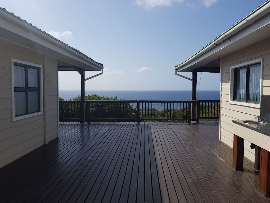 Two units joined by a deck- you can rent out both!