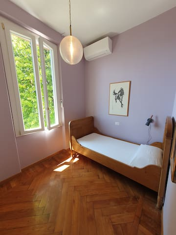 Bedroom 3  (with single bed and air conditioner)
