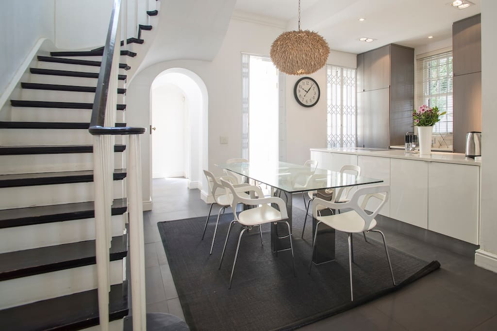 Dining table/kitchen/stairs to upstairs bedrooms