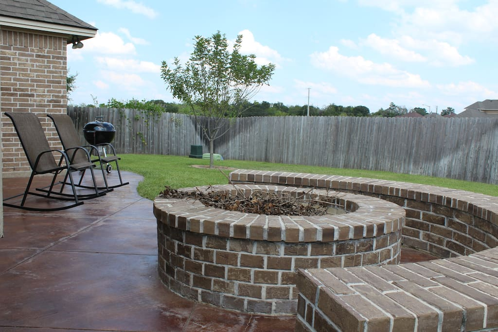 Built in fire pit in the backyard & BBQ grill.
