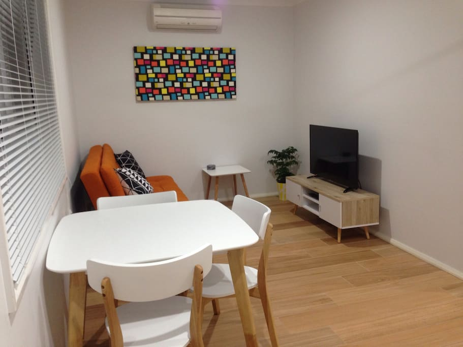 Spacious living/dining area with airconditioner