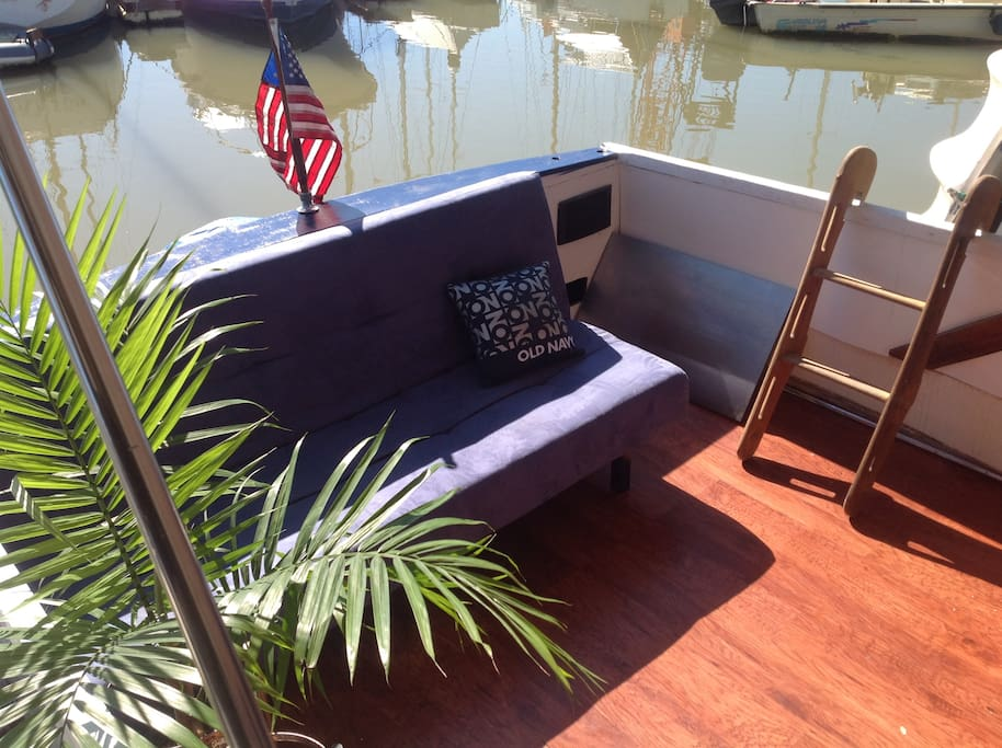 Pilothouse/Deck with sofa and BBQ.