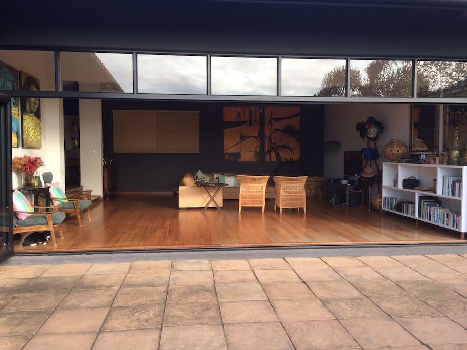 big open doors lead from lounge to verandah
