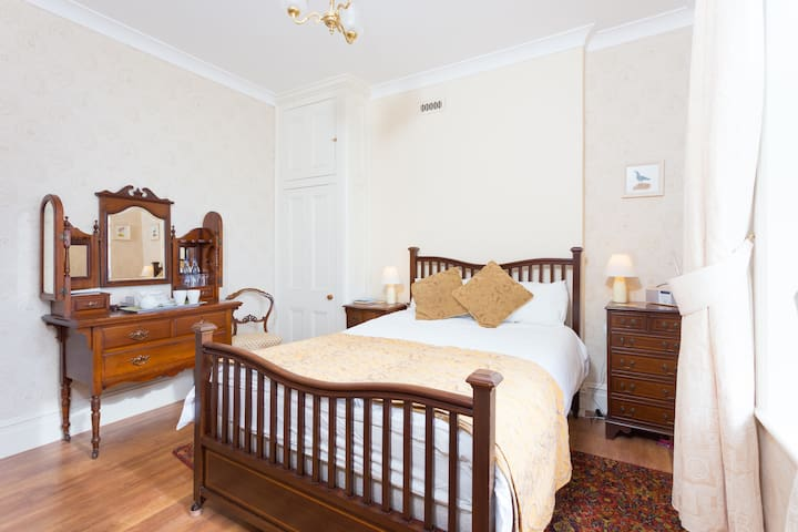 A period double room with view out over the sea