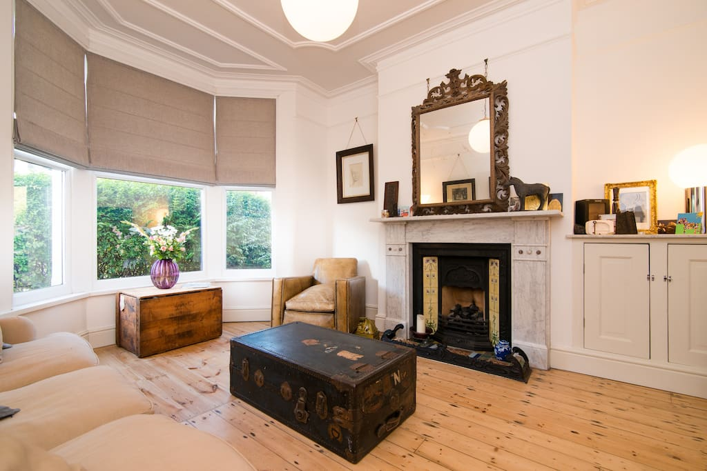 Comfortable sitting room with traditional Victorian features and furniture.