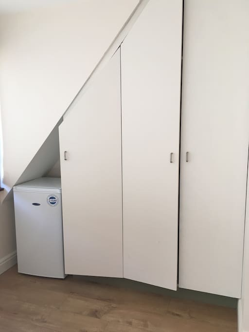 two hanging rails and one wardrobe with shelves