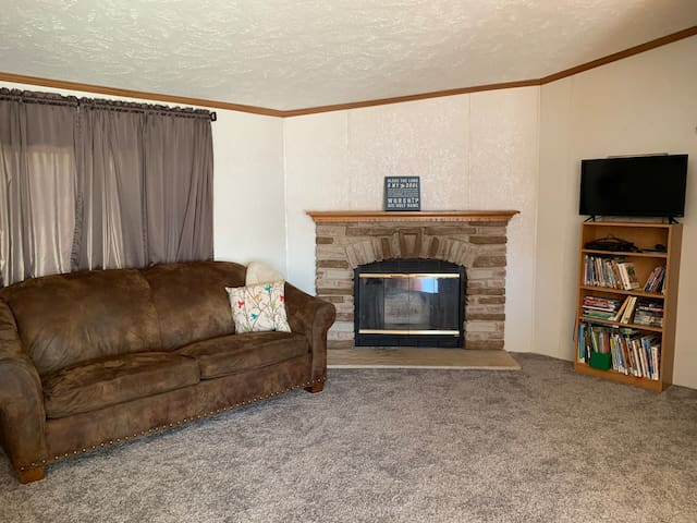 Living room. We place the free standing air conditioner between the fireplace and couch.