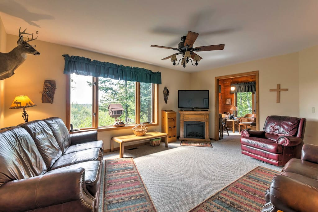 The 1,704-square-foot interior of the cabin is adorned with all the coziest furnishings you can find and sleeps an impressive 13 people!