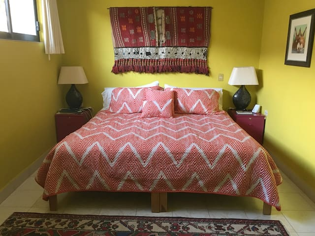 2nd floor master bedroom with king bed and private bath