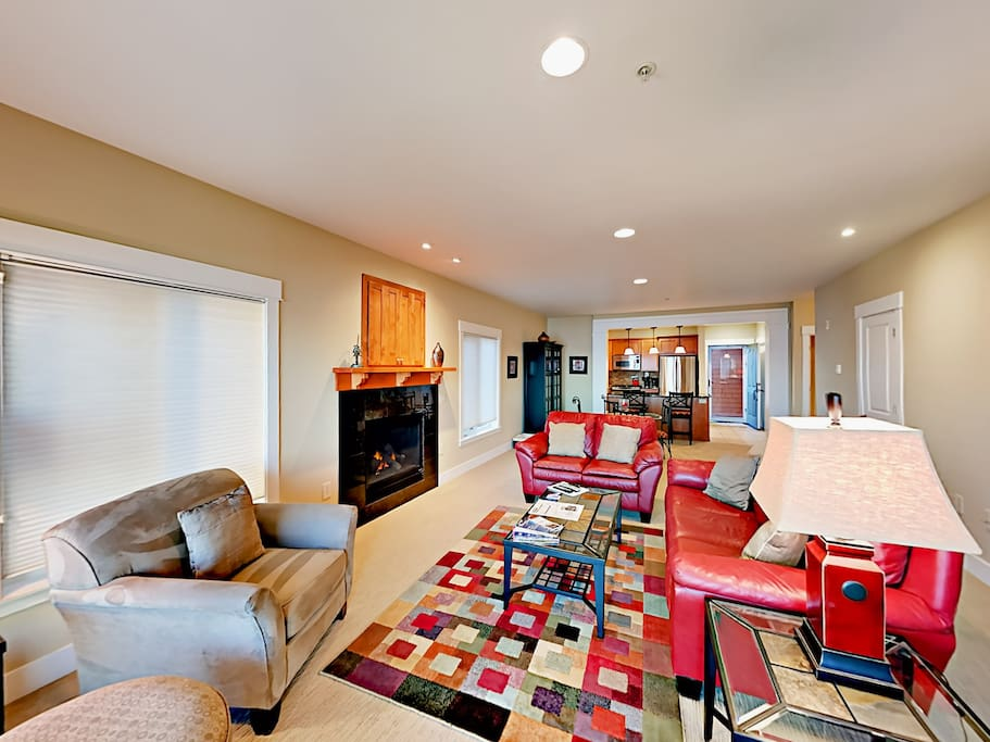 Tastefully designed and decorated with pops of colorful furniture and area rugs.