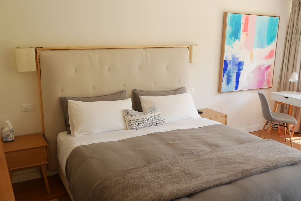 The Master Suite bedroom features original artwork by Melbourne artist Kirsten Jackson - we love it! Sleep on a super comfortable King size mattress (King Koil, top of the range) with quality linen sheets.