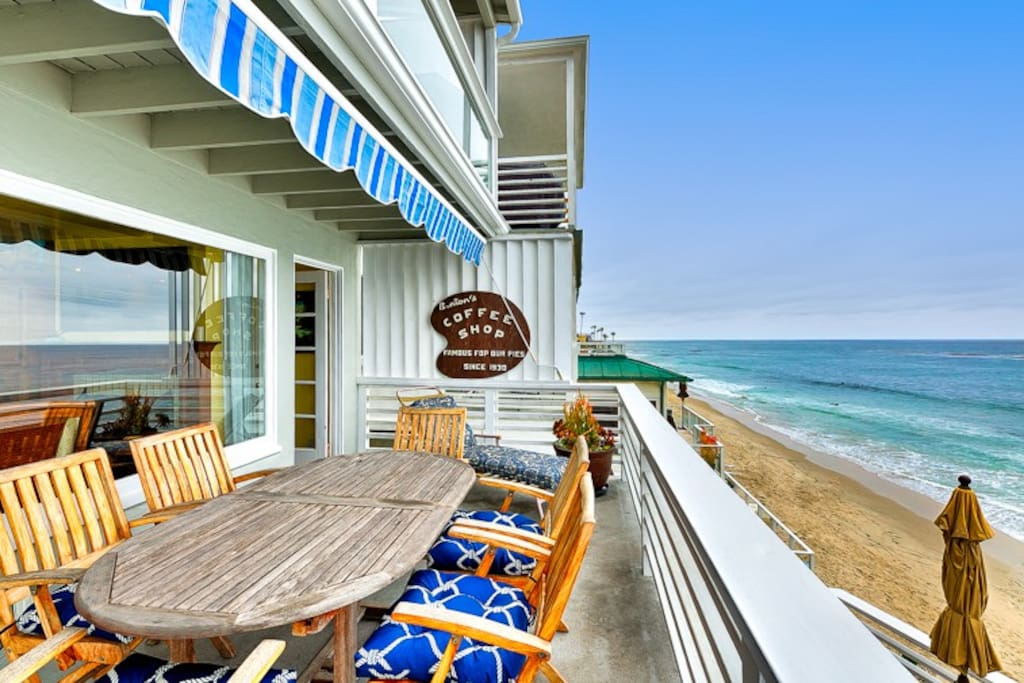 Ocean front deck off of the living room with seating for 6 plus sun bathing chairs