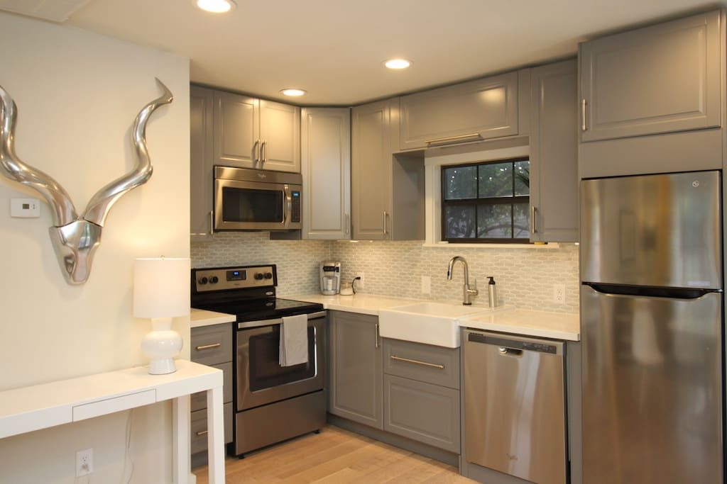 Spacious kitchen fully stocked with all you need including coffee pot, Keurig, and Touch2O Faucet