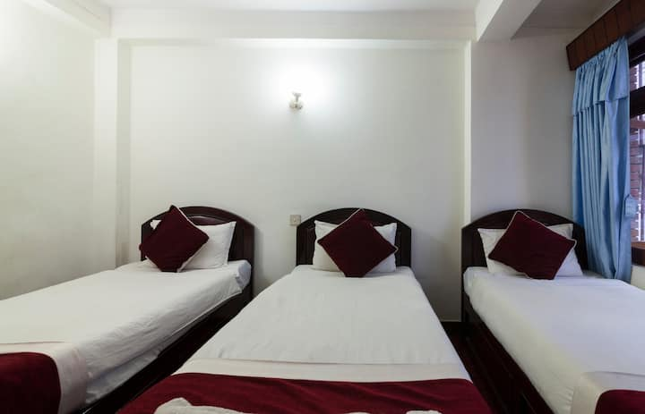 Deluxe triple bed  in hotel lily