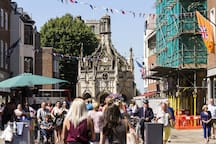 CHICHESTER MARKET CROSS marks the center of the old town & lively shopping district.