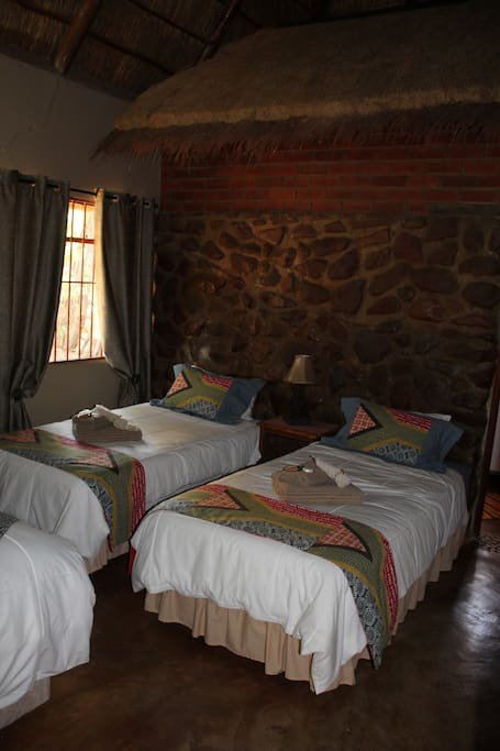 Leopard Tree 2 Single beds can be converted to a kingsize