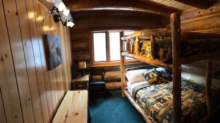 This bedroom is located on the main level same as kitchen main  living room, it has a full-size bunk bed can sleep up to 4 adults.