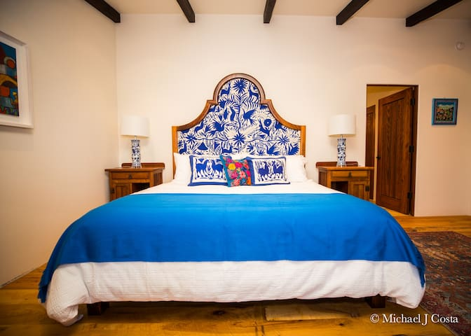 Master bedroom with Otomi head board and  King bed.