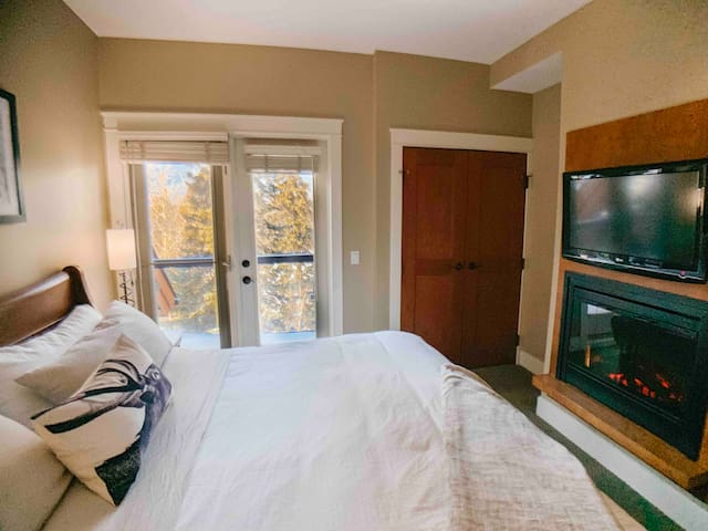 King sized bed, fireplace, HDTV and doors to patio #2/2