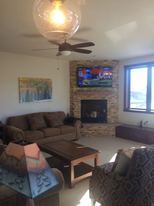 Living room with Large screen TV and gas fireplace