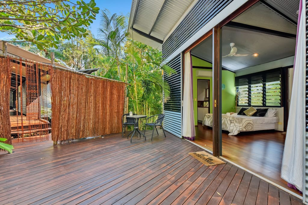 Bungalow separated from main house via deck