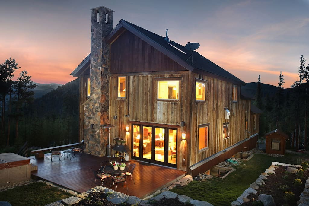 Exterior at Dusk - enjoy spectacular sunsets and panoramic views. Private outdoor hot tub and outdoor seating on deck.