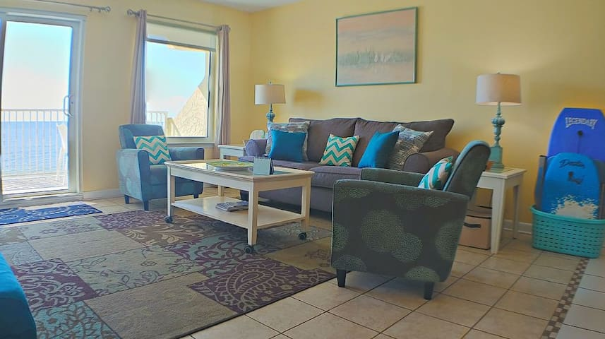 Plenty of room to relax in the living room that overlooks the beach.
