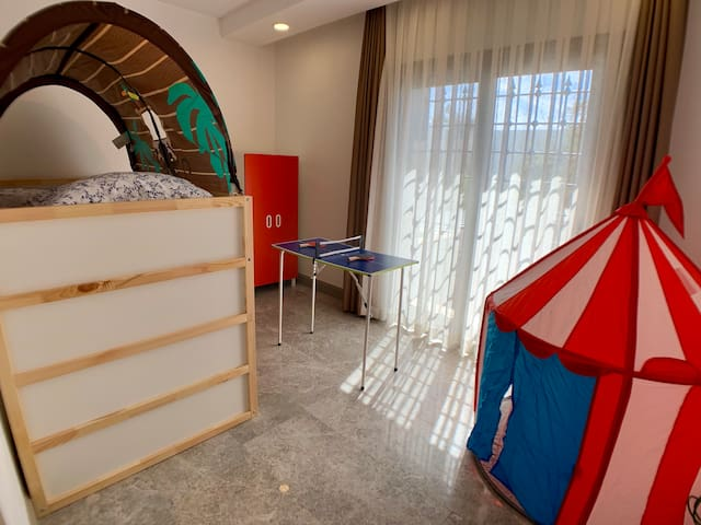 Children bedroom with 2 bed and play area