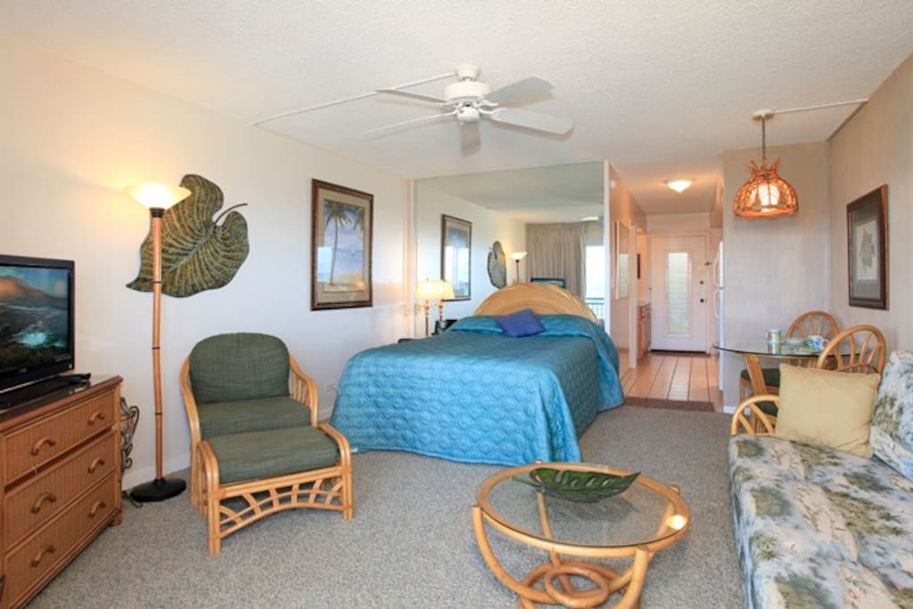 This studio deluxe unit is tropically furnished with a Queen size bed, entertainment center that contains Cable TV, HDTV, DVD player, stereo and FREE WIFI Internet access. Additionally a comfortable sofa sleeper is there for use by an additional person. This condo has recently been remodeled with new paint, HDTV, stereo/MP3 player, Free Wi-Fi, carpet, furniture, a new kitchen and a new tiled shower for your comfort and enjoyment.