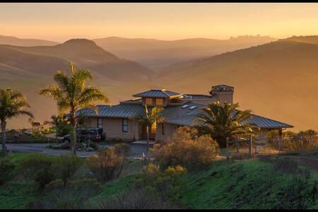 Mountain top house featuring 180° ocean views